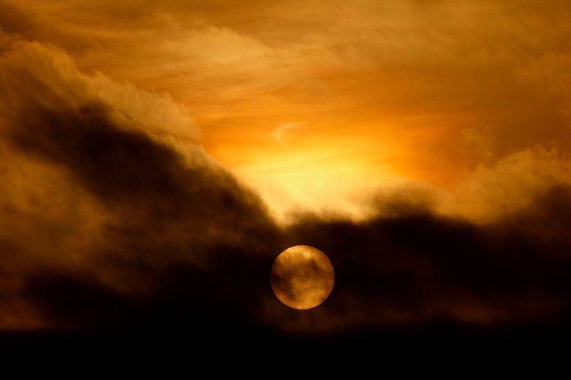 Sun Abstract Beauty In Nature Nature Scenics Tranquil Scene Sky Tranquility Sunset Idyllic Astronomy Planetary Moon Night Cloud - Sky Moon Surface Outdoors No People Low Angle View Half Moon