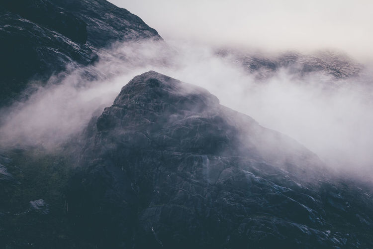Scenic View Of Mountains Amidst Fog