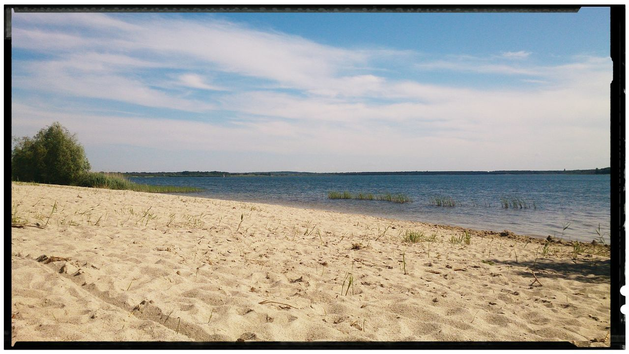 beach, sand, sea, sky, scenics, nature, tranquility, tranquil scene, beauty in nature, water, day, no people, outdoors, vacations, horizon over water, tree