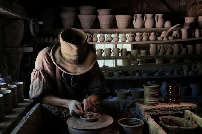 the potter. Old-fashioned Real People One Person Indoors  Craft Craftmanship Pottery Traditional Traditional Craft Handmade Made By Hand Working Hands Hunched Business Stories