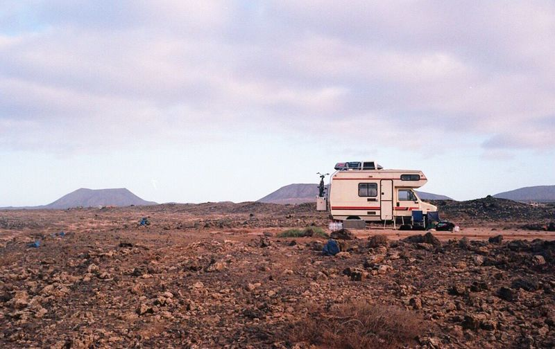 Travel Trailer Parked On Barren Landscape