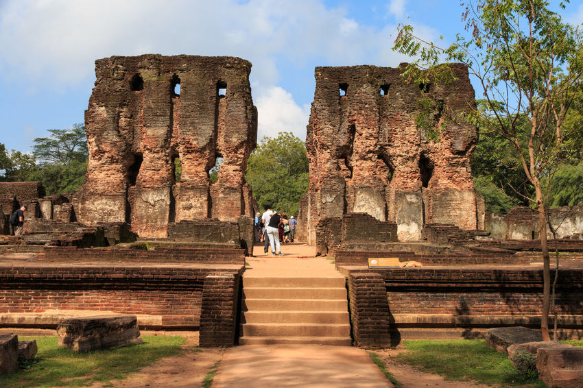 Ancient Ancient Civilization Archaeology Architectural Column Architecture Bad Condition Built Structure Damaged Day History Leisure Activity Lifestyles Men Nature Old Ruin Place Of Worship Real People Religion Sky Sunlight The Past Tourism Travel Travel Destinations Two People