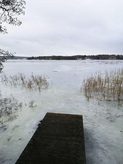 Winter at the lake Möckeln Karlskoga Sweden. Water Tranquility Sky Tranquil Scene Plant Scenics - Nature Nature Lake Reflection Tree No People Day Non-urban Scene Cloud - Sky Wood - Material Idyllic Outdoors Möckeln Ice On The Lake Ice Sky And Clouds Exploring Nature Bridge Over Water