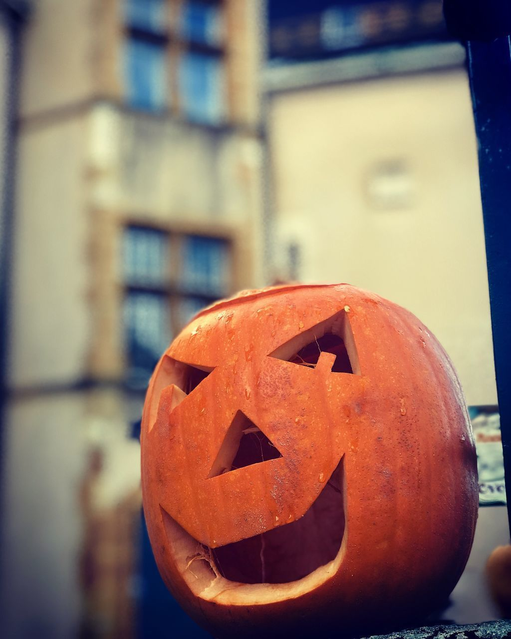 halloween, pumpkin, orange color, jack o' lantern, art and craft, food and drink, anthropomorphic, anthropomorphic face, creativity, face, focus on foreground, food, craft, celebration, no people, architecture, close-up, illuminated, building exterior, outdoors