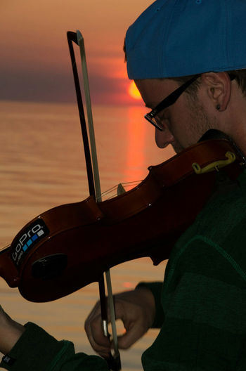 no edit. with flash Canada Coast To Coast No Edit No Filter Sunset_collection Nikon D7000 Grand Bend, Ontario Light And Shadow Flash Photography Nikon Life Ontario, Canada At The Beach Water_collection Musical Instrument Musician Taking Photos Fiddle Sunset