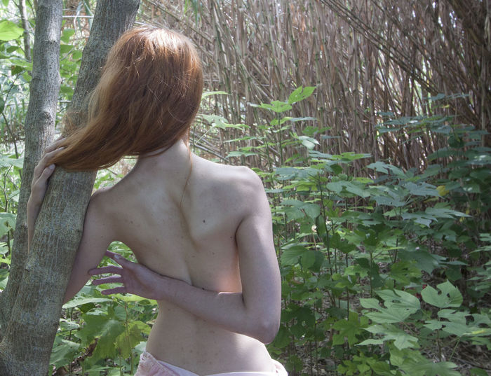 Jorge Omar Gonzalez - caro 1 Day Forest Leisure Activity Lifestyles Nature One Person Outdoors Plant Real People Rear View Shirtless Standing Tree Young Adult Young Women
