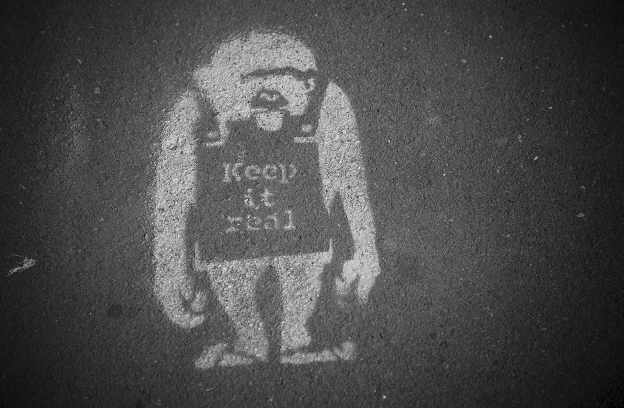 Keep It Real Ape Black & White Black And White Blackandwhite Blackandwhite Photography Close-up Communication Full Frame Keep It Real Monkey No People Outdoors Pavement Pavementporn Real Sandwich Board Tarmac Text Western Script