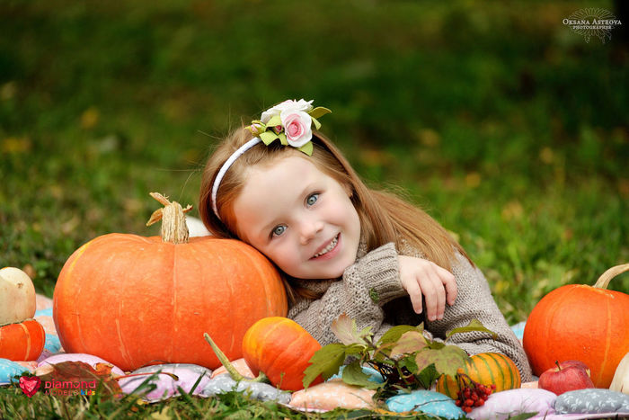 Autumn Celebration Cheerful Child Childhood Children Only Day Food And Drink Girls Gourd Grass Halloween Happiness Holiday - Event Jack O' Lantern Looking At Camera One Girl Only One Person Outdoors People Portrait Pumpkin Smiling Squash - Vegetable Vegetable