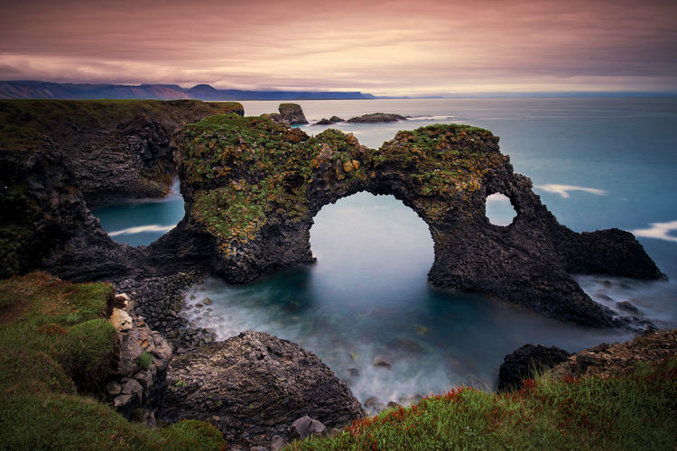 Long exposure of Gatklettur arch rock near Hellnar ,Snaefellsnes Peninsula ,Iceland. Iceland Arch Beauty In Nature Cloud - Sky Hole Land Long Exposure Natural Arch Nature Outdoors Power In Nature Rock Rock - Object Scenics - Nature Sea Sky Sunrise Sunset, Water