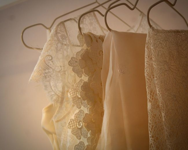 Close-up of clothes hanging on white store
