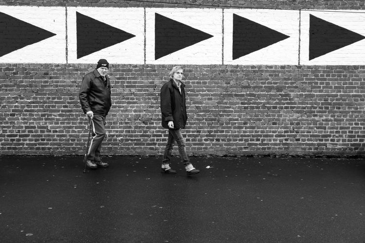 Streetphotography Blackandwhite People Belgium Arrow Way Walk This Way Taking Photos Hello World Getting Inspired Pavement Wall Arrows Arrow Symbol Parking Couple Direction