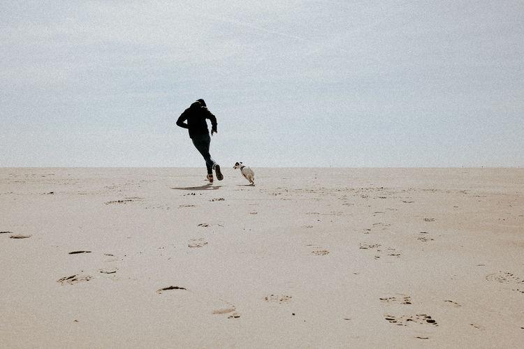 Silhouette of man on beach against sky
