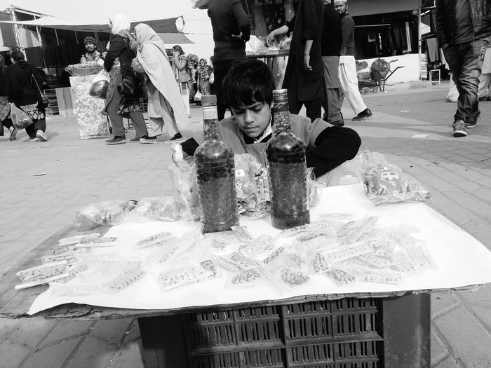 Child Selling To Earn Few Bucks One Person Outdoors Real People Multi Colored People Performance Selling Selling On The Street Selling Art Bottle Childlabor Children_collection Child Labour Childlabour Still Exist Ugly Truth Adult Day