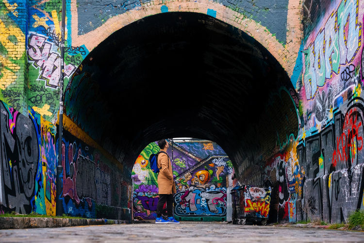Tunnelvision Fujifilm_xseries Streetphotography London Graffiti Multi Colored Street Art Creativity Art And Craft Wall - Building Feature Architecture Paint Built Structure Day Mural One Person Wall Artist Real People Tunnel Outdoors Men