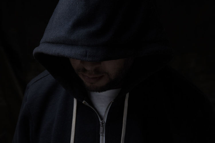 Strange Man Hooded Man Hood One Person Hooded Shirt Headshot Hood - Clothing Black Background Clothing Beard Men Adult Portrait Dark Facial Hair Close-up Front View Young Adult Mystery Lifestyles Studio Shot Obscured Face