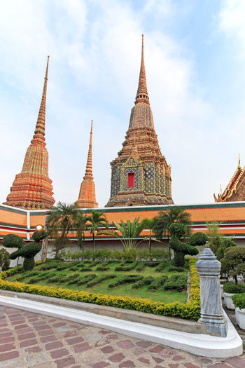 Bangkok, Thailand - April 14, 2015: Wat Pho known also as the Temple of the Reclining Buddha Bangkok Buddhism Buddhist Cultures Day Food Grand Palace Grand Palace Bangkok Thailand Imperial Palace Landmark Market No People Outdoors Place Of Worship Religion Sky Spirituality Temple Thailand Time Vacations Vertical Wat Pho