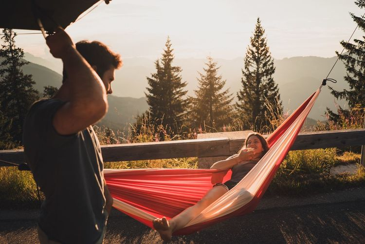 Girl in hammock Van Life Road Trip Roadtrip Couple Hammock Live Authentic Enjoy Life Camping Woman Real People Two People Lifestyles Tree Men Leisure Activity Full Length Lying Down Outdoors Exercising Sky Day Nature People Adult Young Adult Summer Road Tripping Summer Road Tripping