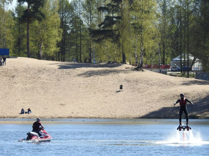 Sharkfly Flyboard Extreme Sports Sankt-Petersburg Sankt-peterburg Russia Colors Of Sankt-Peterburg Lake Landscape Lakeshore Beach Sand Nature Sunnyday☀️ Springtime Sunny Flying Tree Water Men Full Length Water Sport Focus On The Story Adventures In The City
