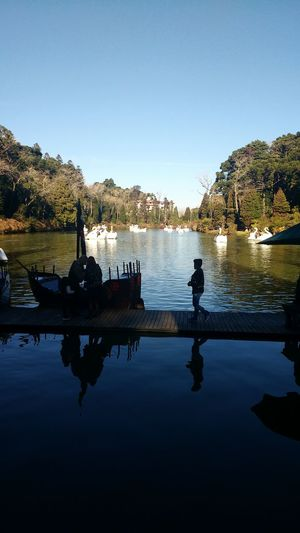 Reflection Water Lake Silhouette Clear Sky Tranquility People Mountain Landscape Outdoors Adult Beach Sky Day Adults Only Nature Beauty In Nature Brazil Lago Negro Rio Grande Do Sul