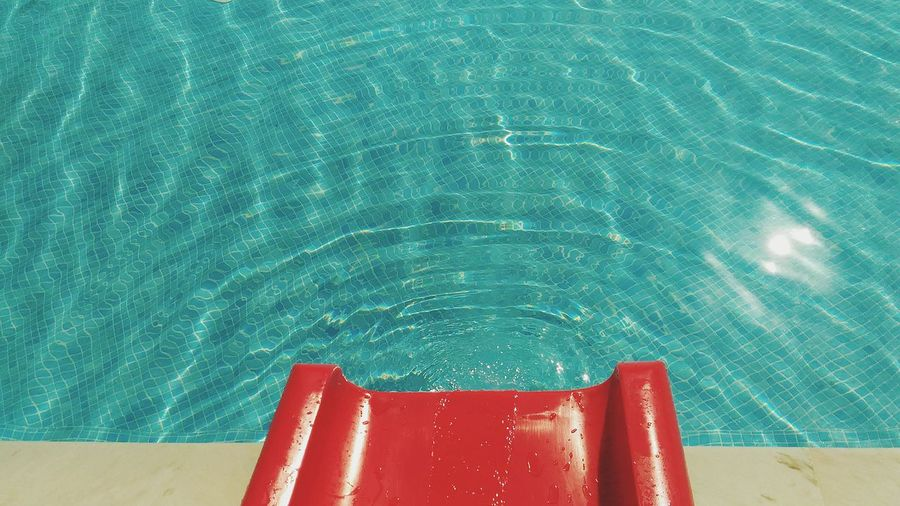 Swimming Pool Red Backgrounds No People Water Day Close-up Swimming Pool Water Outdoors Water Slide Red Water Slide Pattern Negative Space On Water Sommergefühle 100 Days Of Summer EyeEm Selects