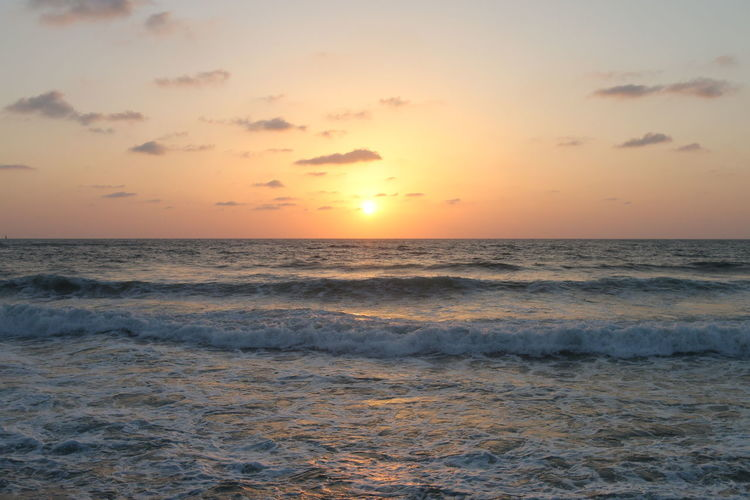 A crazy sunset in Israel Views of the Holy Land Sea Sunset Water Sky Beauty In Nature Horizon Over Water Horizon Motion Scenics - Nature Beach Wave Land Idyllic Tranquility Cloud - Sky Sun Tranquil Scene Orange Color Nature No People Outdoors
