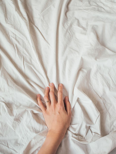 Midsection of person lying on bed