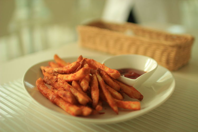 Close-Up Of French Fries With Tomato Ketchup