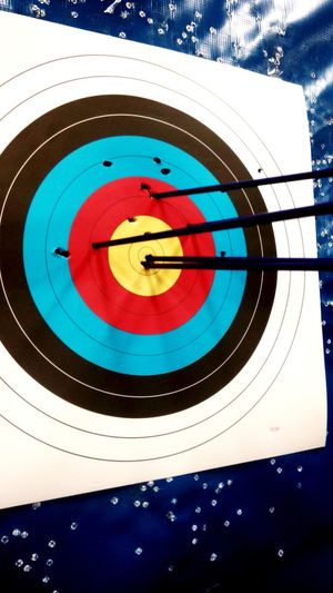 Two bullseye on the first try. Archery Arrow - Bow And Arrow Success EyeemPhilippines Eyeemphotography Photography StillLifePhotography Pattern, Texture, Shape And Form Eyeem Philippines Philippines Weekly Challenge  Sports Target Circle