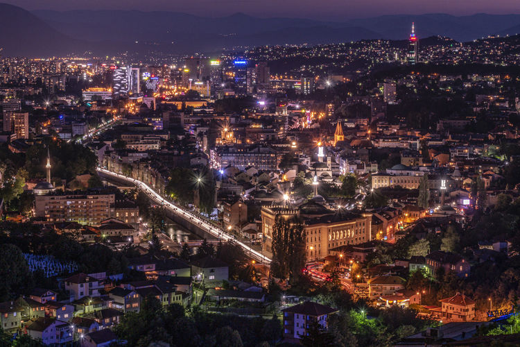 High angle shot of illuminated cityscape at night
