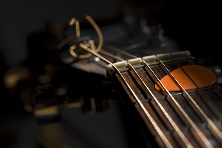 Acoustic Guitar Arts Culture And Entertainment Close-up Focus On Foreground Guitar Illuminated Music Musical Equipment Musical Instrument Musical Instrument String No People Selective Focus Still Life