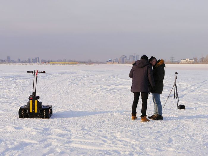 Water Ice Cold Geology Science And Technology Science Vehicle Equipment Snow Technology Work Working Man Russia EyeEm Selects Cold Temperature Warm Clothing Winter City Full Length Photography Themes Water Sky Shore Coast Horizon Over Water Calm Scenics