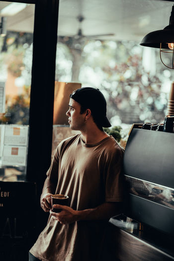 Man in cafe looking through window