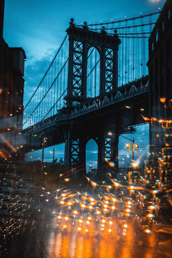 Double exposure of manhattan bridge and lights at night in city
