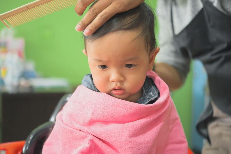 Portrait of cute baby girl looking away