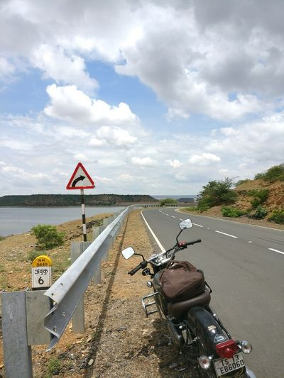 It's Cloud - Sky No People Transportation Outdoors Road Day Sky Water an open highway! First Eyeem Photo Biketouring Bikeride India Roadtripping Travel Photography Landscape Blue Nature Beauty In Nature Lake Lake View Highway Traffic Signs Openroads Royalenfield Lovetotravel