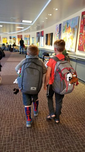 travel buddies Adventure Buddies Traveling In An Airport Airport This Is Family Child Childhood Full Length Boys Technology Friend