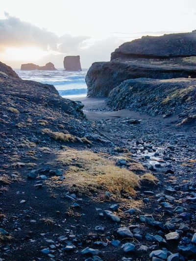 Sunset at the black beach Iceland Black Rock Beach Black Beach Sea Nature Rock - Object Beach Beauty In Nature Water Horizon Over Water Rock Formation Scenics Tranquility Outdoors Sky No People Wave Sunset Pebble Beach