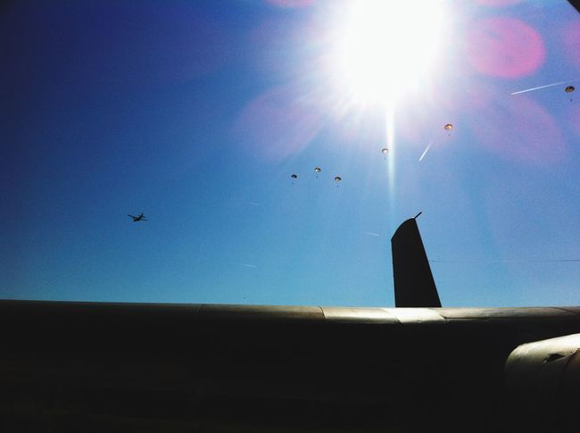 Just working and paratroopers appear over my head Aircraft Paratrooper Sun