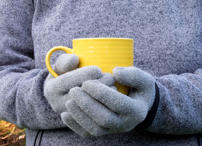 Gardening Close-up Coffee Break Day Gardening Break Holding Human Body Part Human Hand Men One Person Outdoors People Protective Glove Real People Warm Clothing Yellow