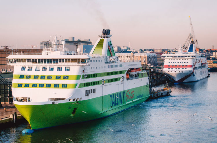 Ferries in passenger port Lansiterminaali in Helsinki. Boat Cargo Colorful Cruise Ship Dock Dusk Ferry Finland Harbour Helsinki Mast Mode Of Transport Nautical Vessel No People Port Ship Smoke Tallink Terminal Transportation Travel Traveling Vacation Water Waterfront
