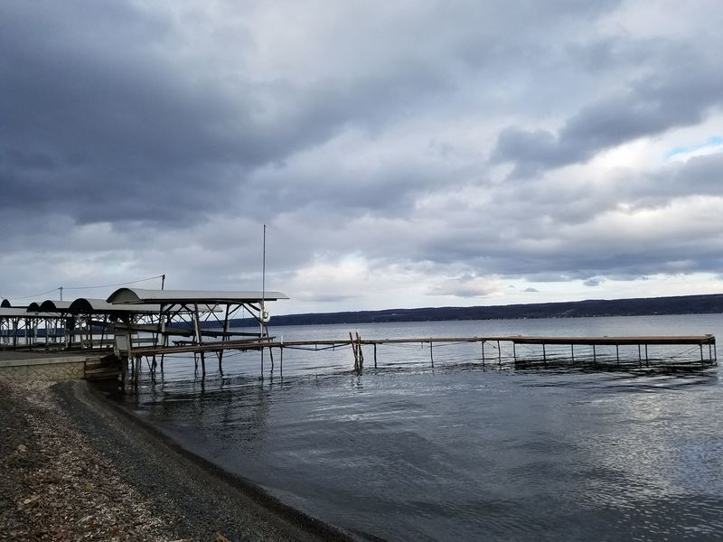 Water Beach Nature Tranquility Pier Tranquil Scene Horizon Over Water No People Scenics Beauty In Nature Outdoors Cloud - Sky SenecaLake Wintertime Winter Cold Temperature Dramatic Sky Storm Cloud Sky Day