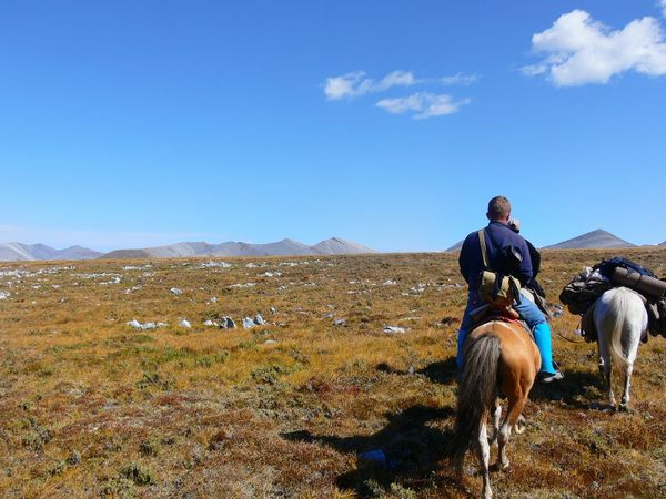 Horseback Riding Horse One Animal Mammal One Man Only One Person People Outdoors Highlands Horseback Traveling Travel Backview Behind Long Goodbye Traveler Freshness Barren Clear Sky Domestic Animals Animal Themes Beauty In Nature Landscape Rocks Mountains TCPM The Great Outdoors - 2017 EyeEm Awards Live For The Story Lost In The Landscape Done That. Been There. Second Acts