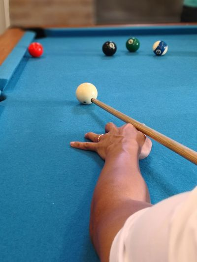 Cropped Image Of Person Playing Pool Ball