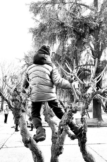 Childhood Child Lifestyles Children Only Leisure Activity Tree Males  Outdoors Real People Day Black & White Blackandwhite City Life Black And White Street Photography Streetphoto_bw Playground