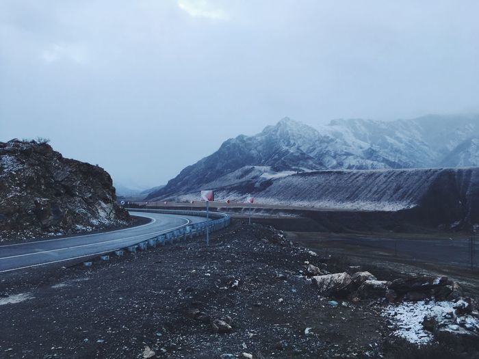 Road by mountains against sky. altay