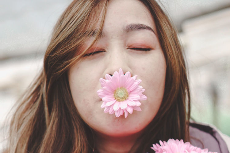 Close-up of beautiful woman with flowers