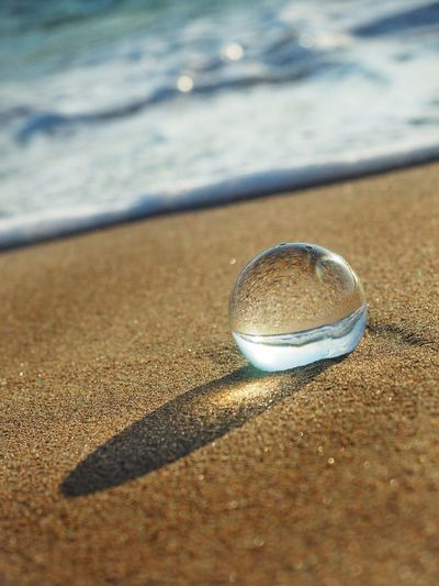 Sea Seascape Beach Beachphotography Romantic Alone Relaxing Relax EyeEm Best Shots EyeEm EyeEm Nature Lover EyeEm Seaview Beachlife Seashore Season  Seaside Water Sea Beach Sand Shadow Reflection Shore Close-up Crystal Ball Fortune Telling Crystal Crystal Glassware Sphere