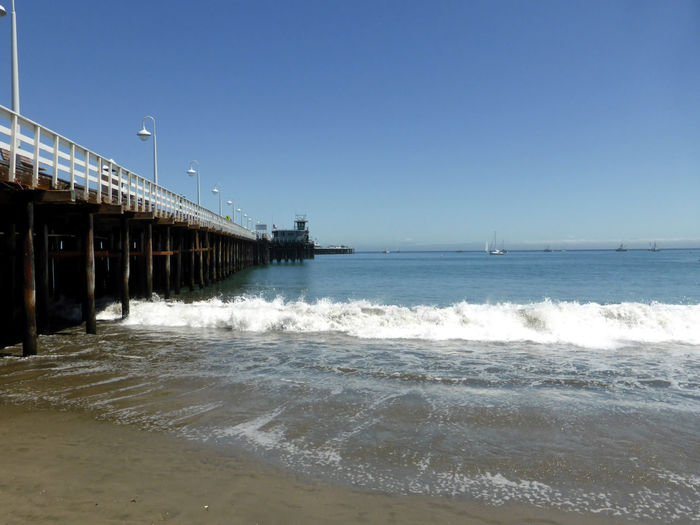 Architecture Beach Beauty In Nature Built Structure Clear Sky Day Nature No People Ocean Outdoors Pier Sea Sea And Sky Sky Water Waves Waves Rolling In