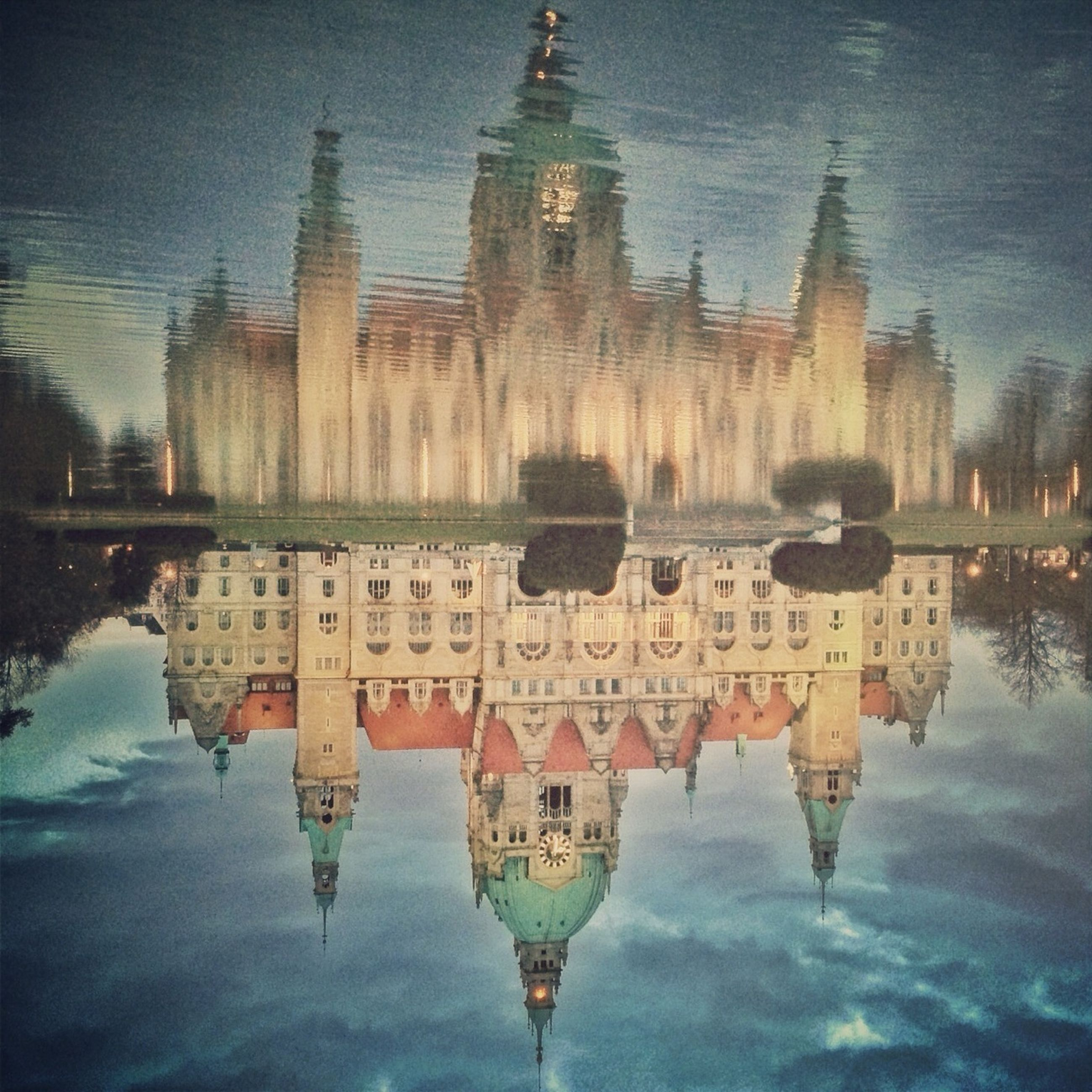 architecture, reflection, built structure, building exterior, water, sky, waterfront, place of worship, cloud - sky, religion, standing water, spirituality, travel destinations, dusk, famous place, lake, outdoors, travel, tourism, history