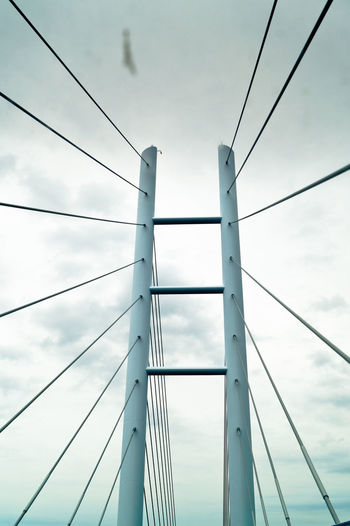 Low Angle View Of Steel Cables Of Suspension Bridge